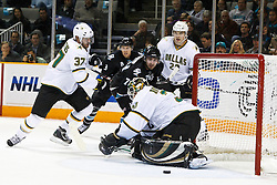 December 13, 2010; San Jose, CA, USA;  Dallas Stars goalie Andrew Raycroft (30) saves a shot from San Jose Sharks center Benn Ferriero (78) during the first period at HP Pavilion. Mandatory Credit: Jason O. Watson / US PRESSWIRE