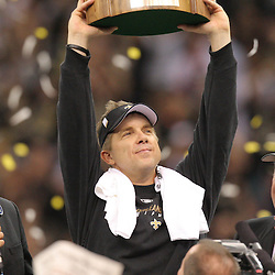 Jan 24, 2010; New Orleans, LA, USA; New Orleans Saints head coach Sean Payton holds up NFC Championship trophy following an overtime victory over the Minnesota Vikings in the 2010 NFC Championship game at the Louisiana Superdome. Mandatory Credit: Derick E. Hingle-US PRESSWIRE