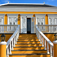 Pasangrahan Town Hall in Kralendijk, Bonaire<br /> This charming colonial building near Wilhelmina Square was constructed for Cornelis Raven Debrot in 1890.  This family became wealthy from harvesting salt and cultivating aloe. After he died in 1921, his former home served several governmental purposes. Following a restoration in 1980, it became the Parliament House for the Island Council.  Many locals refer to it as the Town Hall.