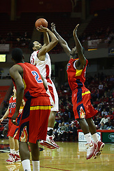 11 December 2010: Jackie Carmichael gets off a jump shot from just outside the lane during an NCAA basketball game between the Illinois - Chicago Flames (UIC) and the Illinois State Redbirds (ISU) at Redbird Arena in Normal Illinois.
