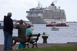 © Licensed to London News Pictures. 03/07/2016. The World approaches the Prom at Gravesend. The World residential cruise ship has arrived in Greenwich, London. MS The World is a residence at sea, carrying wealthy passengers around the world who own apartments on board. The ship, which was launched in 2002, has 165 apartments.  As well as six restaurants, the World has a large lobby, gourmet deli and grocery store, a boutique and showroom, fitness center, billiard room, golf simulator and putting greens, a full-sized tennis court, jogging track, a spa, swimming pool, and cocktail lounge. The World last visited London in 2013. Credit: Rob Powell/LNP