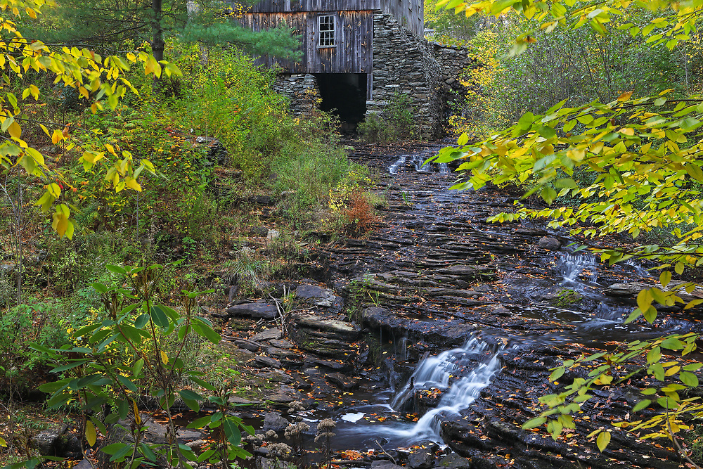 Moore State Park in Paxton is a peaceful retreat in the heart of central Massachusetts. This photo includes the Gristmill and was taken on a beautiful autumn morning when the overcast sky beautifully balanced the light throughout the autumn scenery, bringing out some of those beautiful fall foliage hues.<br />