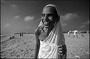 Devotee on the beach at Chennai. She has just had a dip in the sea after a small temple festival.