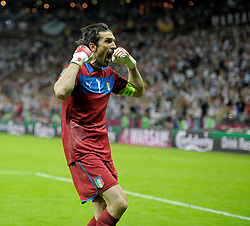 Gianluigi Buffon of Italy celebrates after team-mate Mario Balotelli scored his team's second goal during the UEFA EURO 2012 semi final match between Germany and Italy at the National Stadium on June 28, 2012 in Warsaw, Poland.