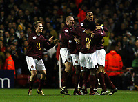 Photo: Chris Ratcliffe.<br /> Arsenal v Juventus. UEFA Champions League. Quarter-Finals. 28/03/2006.<br /> Cesc Fabregas (obscured) celebrates scoring the opening goal for Arsenal with his team mates