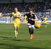 21st April 2018, Dens Park, Dundee, Scotland; Scottish Premier League football, Dundee versus St Johnstone; Simon Murray of Dundee and Jason Kerr of St Johnstone race for the ball