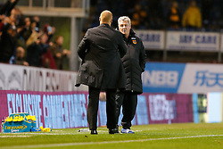 Burnley Manager Sean Dyche is congratulated by Hull City Manager Steve Bruce after Burnley win 1-0 to claim their first victory of the season - Photo mandatory by-line: Rogan Thomson/JMP - 07966 386802 - 08/11/2014 - SPORT - FOOTBALL - Burnley, England - Turf Moor Stadium - Burnley v Hull City - Barclays Premier League.