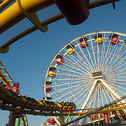 Roller coaster and ferries wheel atSanta Monica Pier amusement park, CA.USA.