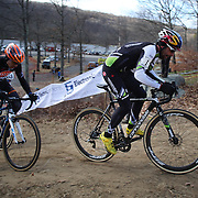 Timothy Johnson, (right), and Kerry Werner in action during the Cyclo-Cross, Supercross Cup 2013 UCI Weekend at the Anthony Wayne Recreation Area, Stony Point, New York. USA. 24th November 2013. Photo Tim Clayton