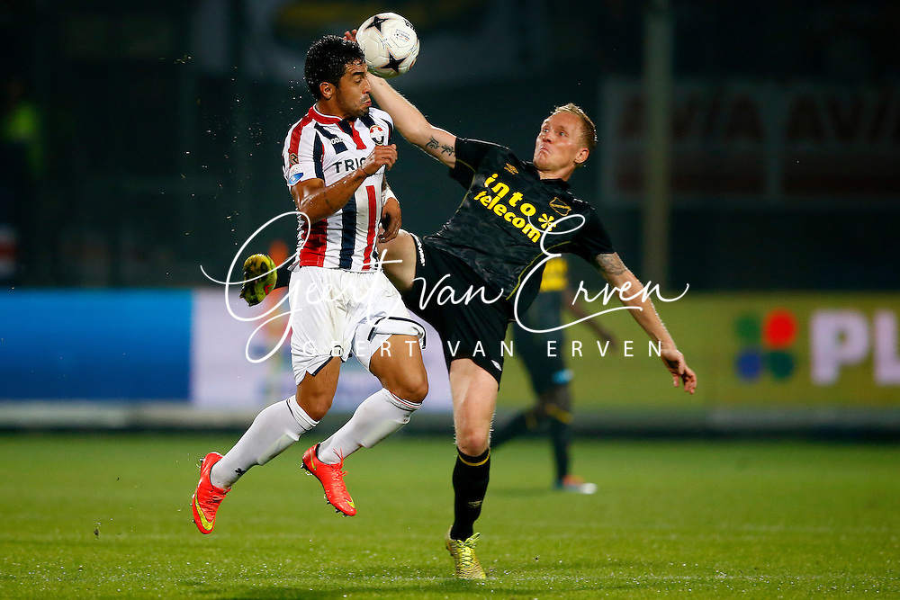Onderwerp/Subject: Willem II - NAC Breda - Eredivisie<br /> Reklame:  <br /> Club/Team/Country: <br /> Seizoen/Season: 2014/2015<br /> FOTO/PHOTO: Bruno ANDRADE ( Bruno Fernandes ANDRADE DE BRITO ) (L) of Willem II in duel with Henrico DROST (R) of NAC Breda. (Photo by PICS UNITED)<br /> <br /> Trefwoorden/Keywords: <br /> #04 $94 &plusmn;1401920268162<br /> Photo- &amp; Copyrights &copy; PICS UNITED <br /> P.O. Box 7164 - 5605 BE  EINDHOVEN (THE NETHERLANDS) <br /> Phone +31 (0)40 296 28 00 <br /> Fax +31 (0) 40 248 47 43 <br /> http://www.pics-united.com <br /> e-mail : sales@pics-united.com (If you would like to raise any issues regarding any aspects of products / service of PICS UNITED) or <br /> e-mail : sales@pics-united.com   <br /> <br /> ATTENTIE: <br /> Publicatie ook bij aanbieding door derden is slechts toegestaan na verkregen toestemming van Pics United. <br /> VOLLEDIGE NAAMSVERMELDING IS VERPLICHT! (&copy; PICS UNITED/Naam Fotograaf, zie veld 4 van de bestandsinfo 'credits') <br /> ATTENTION:  <br /> &copy; Pics United. Reproduction/publication of this photo by any parties is only permitted after authorisation is sought and obtained from  PICS UNITED- THE NETHERLANDS