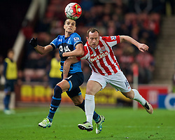STOKE-ON-TRENT, ENGLAND - Monday, April 18, 2016: Tottenham Hotspur's Erik Lamela is fouled by Stoke City's Charlie Adam during the FA Premier League match at the Britannia Stadium. (Pic by David Rawcliffe/Propaganda)