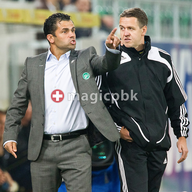FC St.Gallen headcoach Ulrich (Uli) Forte gestures while being watched by the 4th referee Dani Wermelinger (R) during the Super League (National League A) soccer match between FC St. Gallen (FCSG) and BSC Young Boys (YB) at the AFG arena in St.Gallen, Switzerland, Wednesday, September 22, 2010. (Photo by Patrick B. Kraemer / MAGICPBK)