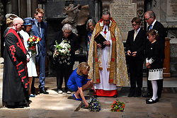 Lucy Hawking lays flowers as the ashes of her father, Professor Stephen Hawking, are laid to rest during his memorial service at Westminster Abbey, London.