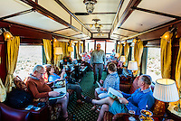 """Passengers sitting in the observation car, Rovos Rail train  """"Pride of Africa"""" between Pretoria and Cape Town, South Africa."""