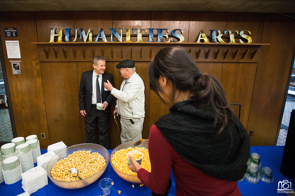 Attendees enjoy complimentary kettle corn and drinks during Humanities & Arts Day Student Showcase at San Jose State University's Student Union Barrett Ballroom in San Jose, California, on October 25, 2013. (Stan Olszewski/SOSKIphoto)