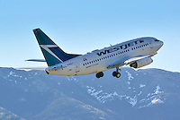Westjet Boeing 737-600 taking off in Whitehorse, Yukon