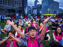 June 15, 2018 - Seoul, Gyeonggi, South Korea - South Koreans cheer during a rally to mark the anniversary of the signing of the June 15th North-South Joint Declaration between South Korea and North Korea. The Declaration was negotiated by late South Korean President Kim Dae-jung and North Korean leader Kim Jong-il and signed on 15 June 2000. It was a part of South Korea's ''Sunshine Policy,'' which guides the South's relationship with North Korea. This year's observance of the anniversary was bolstered by the recent thawing in relations between North Korea and South Korea and the US. (Credit Image: © Jack Kurtz via ZUMA Wire)