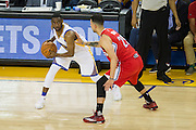 Golden State Warriors guard Ian Clark (21) looks for an open teammate during a NBA preseason game against the Los Angeles Clippers at Oracle Arena in Oakland, Calif., on October 4, 2016. (Stan Olszewski/Special to S.F. Examiner)