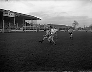 15/02/1959<br /> 02/15/1959<br /> 15 February 1959<br /> Soccer, F.A.I. Cup: Waterford v Transport at Harold's Cross, Dublin. Waterford's Peter Fitzgerald (centre) keeps well up on Transport's back, M. Wheelan who tries to clear the ball.