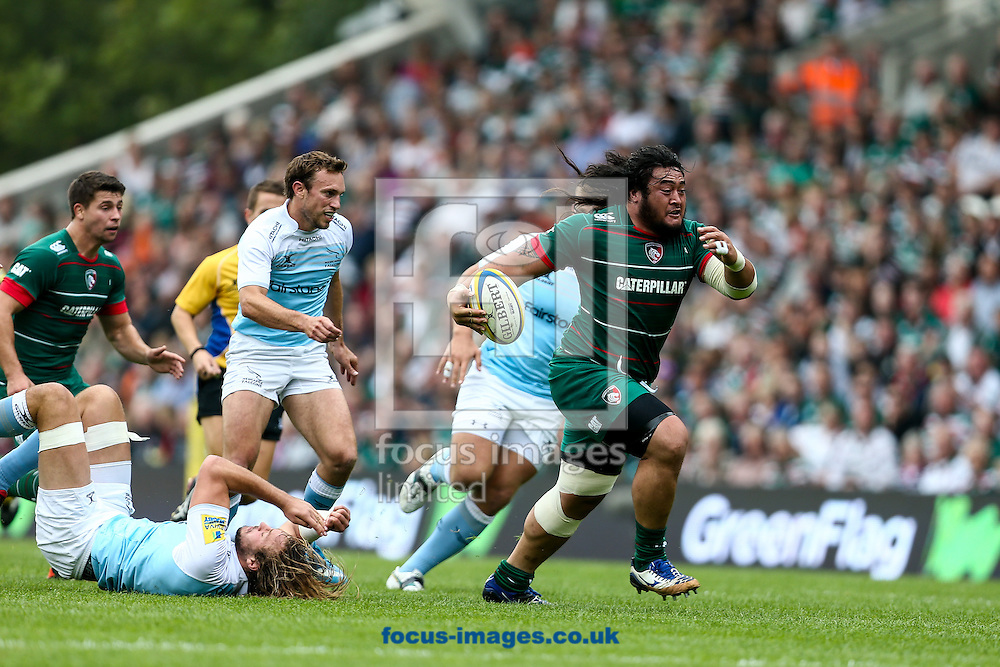 Logovi'i Mulipola of Leicester Tigers (right)  makes a break during the Aviva Premiership match at Welford Road, Leicester<br /> Picture by Andy Kearns/Focus Images Ltd 0781 864 4264<br /> 06/09/2014