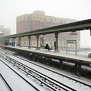 A few commuters wait expectantly at a train station in Yonkers, New York, during a blizzard in 2005, hoping a train will arrive before thickening snow halts all rail movement.