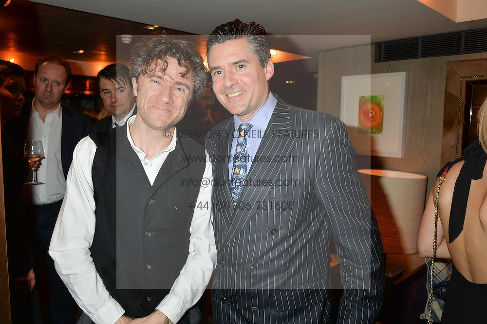 Left to right, THOMAS HEATHERWICK and EDWARD TAYLOR at the 3rd birthday party for Spectator Life magazine hosted by Andrew Neil and Olivia Cole held at the Belgraves Hotel, 20 Chesham Place, London on 31st March 2015.