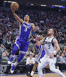 February 3, 2018 - Sacramento, CA, USA - The Sacramento Kings' George Hill (3) drives to the basket against the Dallas Mavericks' J.J. Barea (5) at the Golden 1 Center in Sacramento Calif., on Saturday, Feb. 3, 2018. (Credit Image: © Hector Amezcua/TNS via ZUMA Wire)