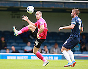 Peterborough United player Conor Washington looks to control a high ball under pressure from Southend player John White during the Sky Bet League 1 match between Southend United and Peterborough United at Roots Hall, Southend, England on 5 September 2015. Photo by Bennett Dean.