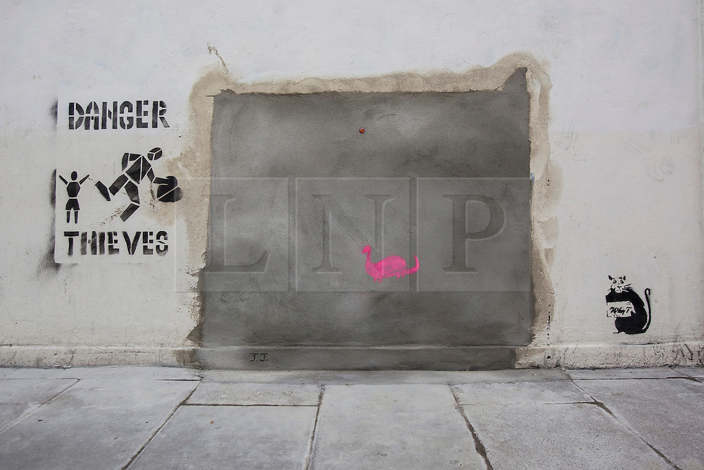 © licensed to London News Pictures. London, UK 22/02/2013. Graffiti artworks thought to be Banksy's new work appears at the site of 'stolen' mural in Turnpike Lane, next to a Poundland branch. Photo credit: Tolga Akmen/LNP