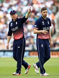 England's captain Eoin Morgan (left) and Mark Wood during the ICC Champions Trophy, Group A match at The Oval, London.