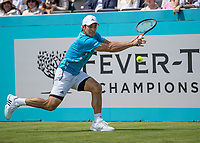 Tennis - 2019 Queen's Club Fever-Tree Championships - Day One, Monday<br /> <br /> Men's Singles, First Round: Marin Cilic (CRO) Vs. Christian Garin (CHL)  <br /> <br /> Christian Garin (CHL) stretches to reach the passing shot on Centre Court.<br />  <br /> COLORSPORT/DANIEL BEARHAM