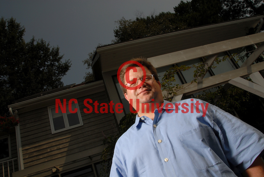 Executive Director of the North Carolina Solar Center, Steve Kalland outside the Solar House. PHOTO BY ROGER WINSTEAD