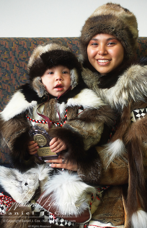 Qinugan Rexford and San Devin Tiegland pose in Inuit dress. Barrow, Alaska