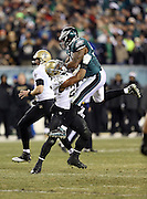 Philadelphia Eagles outside linebacker Trent Cole (58) leaps in the air as he gets blocked by New Orleans Saints running back Mark Ingram (22) during the NFL NFC Wild Card football game against the New Orleans Saints on Saturday, Jan. 4, 2014 in Philadelphia. The Saints won the game 26-24. ©Paul Anthony Spinelli