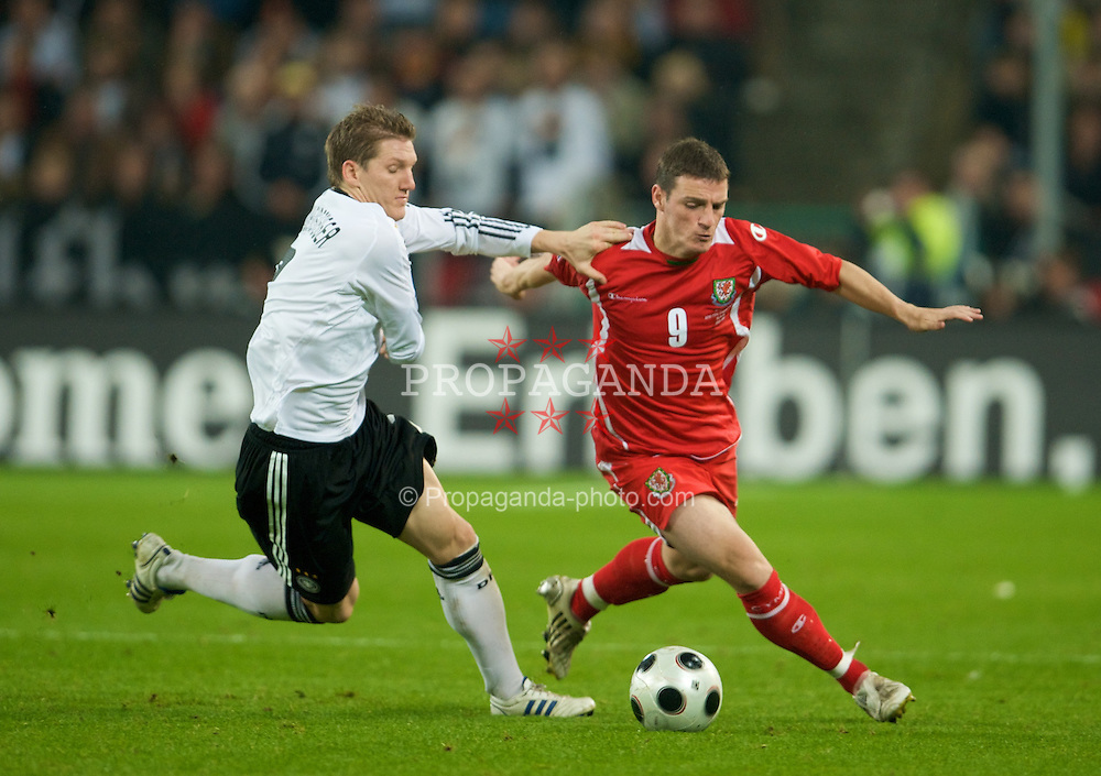 MONCHENGLADBACH, GERMANY - Wednesday, October 15, 2008: Wales' Jason Koumas and Germany's Bastian Schweinsteiger during the 2010 FIFA World Cup South Africa Qualifying Group 4 match at the Borussia-Park Stadium. (Photo by David Rawcliffe/Propaganda)