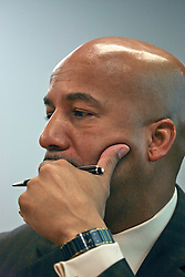 September 12 2006 - New Orleans, Louisiana. Mayor Ray Nagin presides over a meeting at City Hall to present the results of his '100 day plan,' the much touted plan announced the day of his re-election to a second term in office 100 days earlier. At one point in the presentation a Fleur de Lis can be seen projected onto his forehead from the slide show presentation.<br /> Photo credit; Charlie Varley.