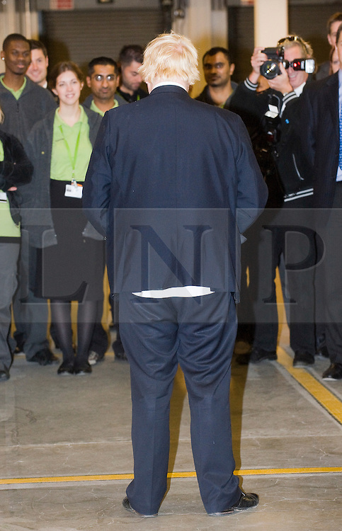 © Licensed to London News Pictures. 21/10/2011. London, UK. Mayor of London Boris Johnson with his shirt hanging out while taking to Waitrose staff members following  a tour of Waitrose's state of the art online distribution centre in Acton, West London today (21/10/2011). The centre delivers online order across the whole of London. Photo credit: Ben Cawthra/LNP