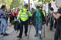 © Licensed to London News Pictures. 09/10/2019. London, UK. Police detain DAVID (who has five great grand children) outside Cabinet Office in Westminster on day three of the two weeks protest by environmental and climate change activists. The activists are calling for the government to act on climate change. Photo credit: Dinendra Haria/LNP
