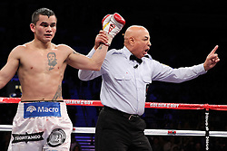 December 11, 2010; Las Vegas, NV; USA; Referee Joe Cortez deducts a point from Marcos Maidana for elbowing Amir Khan during their 12 round WBA 140lb championship bout at the Mandalay Bay Events Center in Las Vegas, NV.  Khan won via unanimous decision.  Photo: Ed Mulholland/HBO  (HBO Usage Only)