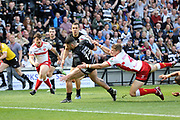 Hull FC outside back Jake Connor (14) scores the opening tryduring the Betfred Super League match between Hull FC and Hull Kingston Rovers at Kingston Communications Stadium, Hull, United Kingdom on 19 April 2019.