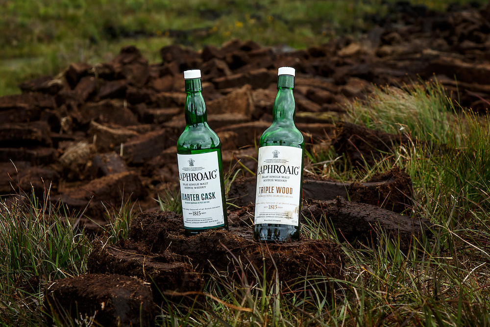 Bottle of Laphroaig Scotch Whisky sit in the peat bogs that are harvested for use at Laphroaig Distillery at Port Ellen, Isle of Islay, Scotland, July 17, 2015. Gary He/DRAMBOX MEDIA LIBRARY