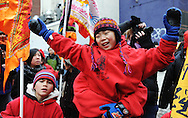 February 13, 2011 - A Gund Kwok volunteer cheers on members as they perform in New Year celebrations in Boston's China Town. .