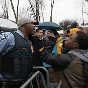 Minneapolis Police Officer A. Knight briefly engages in conversation with the crowd, some of whom were yelling arguments and sometimes insults at officers, during Black Lives Matter protests outside the Minneapolis Police Department 4th precinct headquarters on Wednesday, November 18, 2015 in Minneapolis, Minnesota. <br /> <br /> Activists who had been camped out in the front entrance to the precinct were cleared out earlier in the day. Protests and the encampment came in reaction to the shooting of 24-year-old Jamar Clark by Minneapolis Police on Sunday. <br /> <br /> <br /> Photo by Angela Jimenez for Minnesota Public Radio www.angelajimenezphotography.com