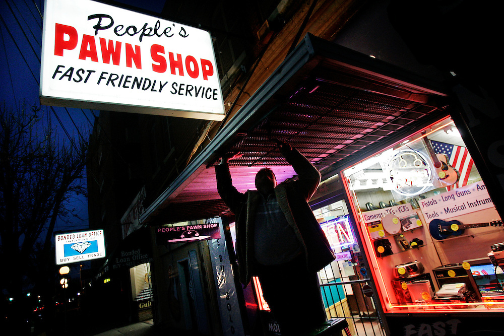 Columbia, SC 1/4/10 Gerry Melendez/gmelendez@thestate.com ---Greg Pipkin, an employee at the People's Pawn Shop since 2001, gets ready to close on a Monday evening.