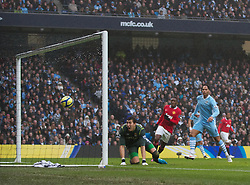 MANCHESTER, ENGLAND - Sunday, January 8, 2012: Manchester City's goalkeeper Costel Pantilimon is beaten for the opening goal during the FA Cup 3rd Round match against Manchester United at the City of Manchester Stadium. (Pic by Vegard Grott/Propaganda)