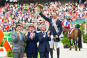 Patrice Delaveau and Orient Express HDC second in the Final Four. In front of the podium second from left Dr. Pearse Lyons, Founder and President of Alltech<br /> Alltech FEI World Equestrian Games™ 2014 - Normandy, France.<br /> © DigiShots