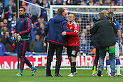 Manchester United Manager Louis van Gaal congratulates Wayne Rooney of Manchester United after the The FA Cup semi final match between Everton and Manchester United at Wembley Stadium, London, England on 23 April 2016. Photo by Phil Duncan.