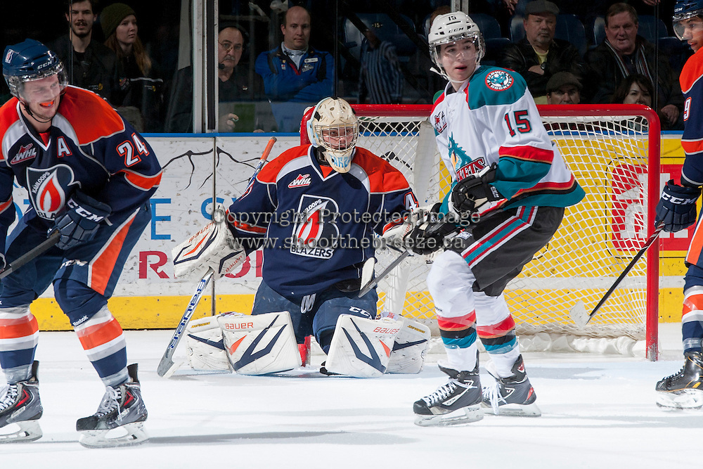 KELOWNA, CANADA - DECEMBER 27: Tate Coughlin #15 of the Kelowna Rockets looks for the pass in front of the net of Taran Kozun G #41 of the Kamloops Blazers on December 27, 2013 at Prospera Place in Kelowna, British Columbia, Canada.   (Photo by Marissa Baecker/Shoot the Breeze)  ***  Local Caption  ***