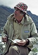 "Sir Edmund Hillary (born 1919, died 11 January 2008) is 62 years of age here at Kunde Hospital in 1981, Nepal, Asia. I first encountered him moving planks for building a diesel fuel storage shed for his Kunde Hospital. He later magnanimously signed autographs for our group of trekkers. We discussed the weather and logistics of helping a member of our team who had fallen altitude sick at Lobuje and had been carried semi-conscious to Tengboche for helicopter rescue. ""My doctor tells me to stay below 12,000 feet,"" Sir Edmund remarked, as he stood comfortably at 12,600 feet. For licensing options, please inquire."