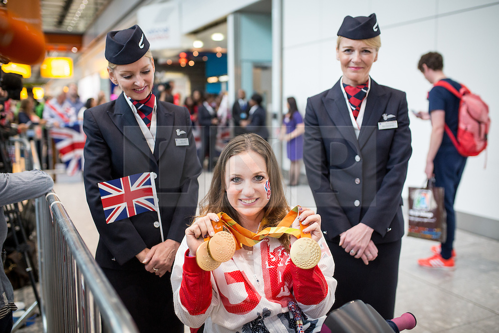 © Licensed to London News Pictures. 20/09/2016. London, UK. Team GB Paralympian NATASHA BAKER arrives at terminal 5 of London Heathrow Airport after flying on British Airways flight BA2016. Baker won three golds in equestrian events. Team GB finished second in the Paralympics medals table with 147 medals beating their total of 120 at London 2012. Photo credit : Tom Nicholson/LNP